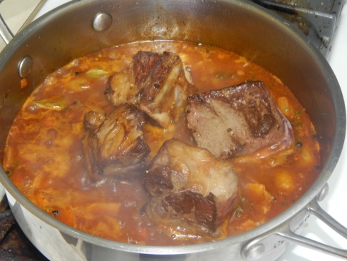 Saute veggies, add red wine, stock, and tomato paste. Let short ribs take a nice, long bath.