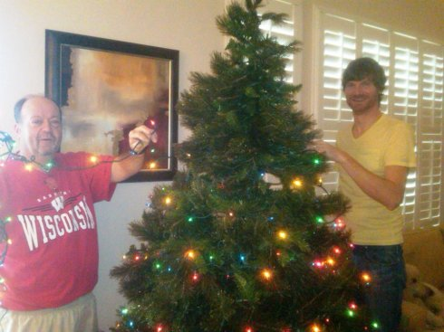 Mike and Dad trim up the tree.