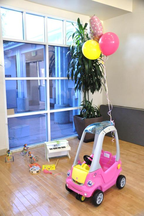 Margot's wonderful nanny gifted her with a hot pink car.
